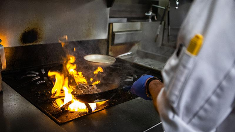 chef with flame on stove